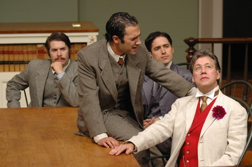 Oscar Wilde (far right, JM Richardson) listens to the advice of friend Frank Harris (seated at table, Patrick Poole) with ensemble cast members (l-r) Tom Bentley and Ryan Maxwell.