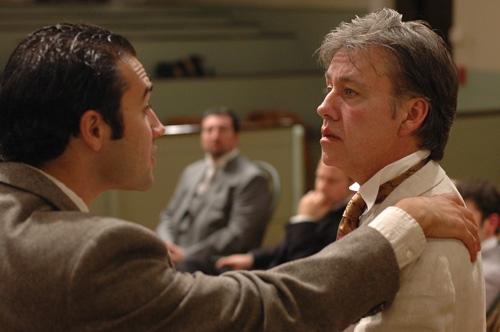 Frank Harris (left, Patrick Poole) comforts his friend Oscar Wilde (right, JM Richardson) while attorneys (rear l-r) Edward Clarke (Joe Henderson) and Edward Carson (Michael Zola) ponder their next move.