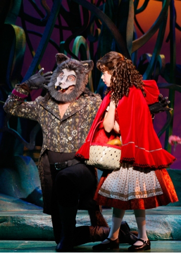The Wolf (Michael Hunsaker) distracts Little Red Ridinghood (Ireland Woods) from her journey to Grandmother's house
