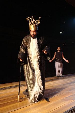 (l-r) King Pelias (Allen Gilmore) tells his servant (Jesse J. Perez) about a dark prophecy
