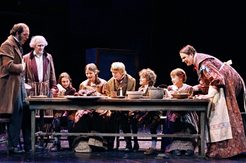 Michael Booth (Bob Cratchit), Raye Birk (Ebenezer Scrooge), Lily Jones (Tiny Tim), Alondra Kingman (Martha Cratchit), Ryan Skajewski (Peter Cratchit), Tucker Garborg (Tom Cratchit), Kate Howell (Belinda Cratchit), and Beth Gilleland (Mrs. Cratchit) at 'A Christmas Carol' at The Guthrie
