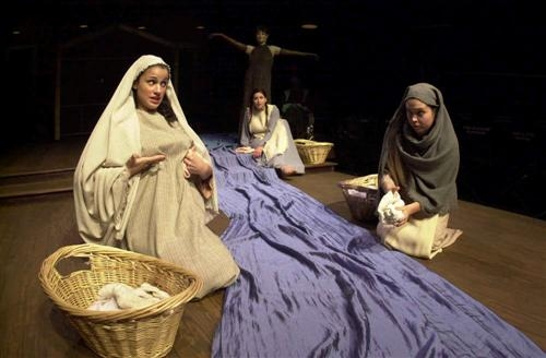 Local village women (far left, Ashley Kenner & far right, Erin Olson) discuss the virtues of family life while Mary (Gabby Sherba) looks on horrified with the Tree (Isabel O'Donnell) quietly listens.
