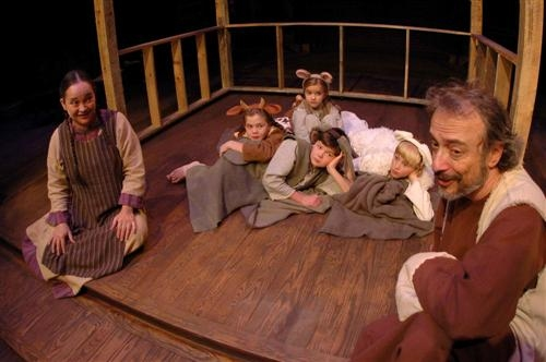 Girl (Amy Thompson) offers her parent's stable to Joseph (far right), which is filled with animals (l-r) including Cow (Eileen Kinnane), Mouse (Patricia Kinnane), Donkey (Evan Kinnane), and Sheep (Owen Newsome).