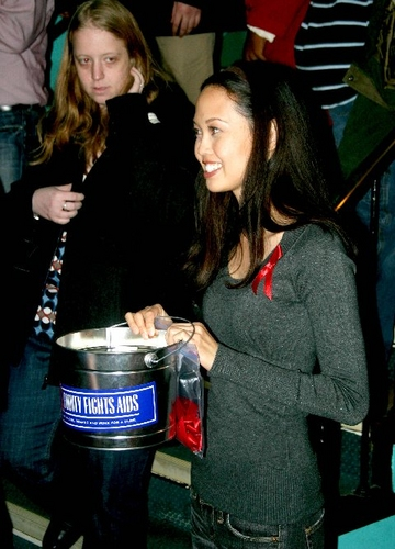 Jennie Kwan collects money for BC/EFA after the show
