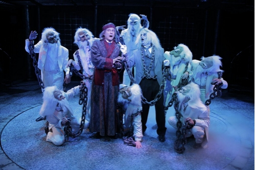 """David Edwards (Scrooge) Gary Troy (Marley) and Spirits performing """"Welcome to the Cha Photo"""