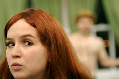 Anne Gridley (foreground), Zachary Oberzan (background)