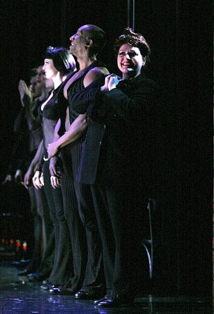 Aida Turturro with the cast of Chicago
