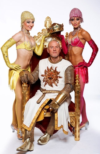 Alan Dale with the vixens of Camelot