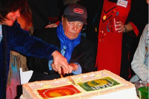 Tom O'Horgan cuts the cake