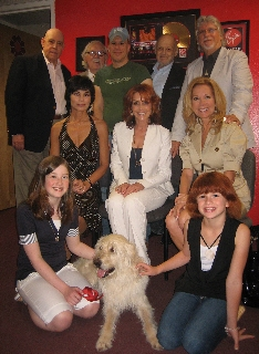Back: John Schuck (Daddy Warbucks), Thomas Meehan (book writer), Robert Sher (CD producer), Charles Strouse (composer), Martin Charnin (original director and lyricist). Seated: Shelley Burch (Annie), Andrea McArdle (Annie), Kathie Lee Gifford (Miss Hanni