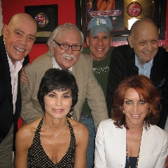 TOP: John Schuck (Daddy Warbucks), Thomas Meehan (book writer), Robert Sher (cd producer), Charles Strouse. BOTTOM: Shelley Bruce (Annie), Andrea McArdle (Annie)