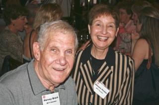 Harvey Brock, alumni guild and former board member, and Elenore Parker, alumna, former president, and vp of pr