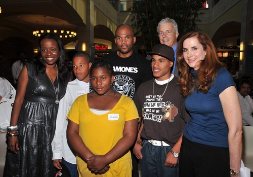 "Jeannette Bayardelle, Darryl ""D.M.C"" McDaniels, Herbert Stoop, and Laurie Sherman with the children"
