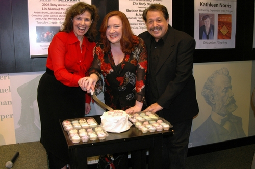 Kayce Glasse, Lisa Asher and Ellis Nassour cutting the cake