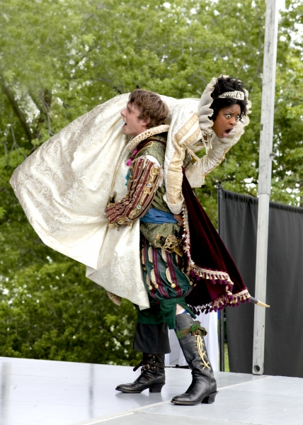 Petruchio (Matt Mueller) carries off his bride Katherina (Ericka Ratcliff).
