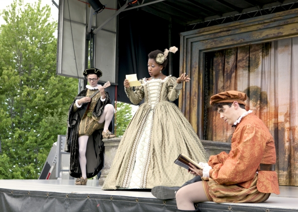 Bianca (Tiffany Yvonne Cox) is tutored by two suitors, Hortensio (L: Matthew Sherbach) and Lucentio (R: Jarrod Zimmerman)