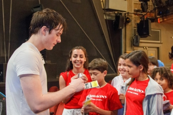 Broadway's Matthew James Thomas signs autographs after having a talk back with our student's after seeing Spider-Man: Turn Off The Dark. at Ben Cameron, Matthew James Thomas and More at A Class Act NY's 2012 Summer Camp