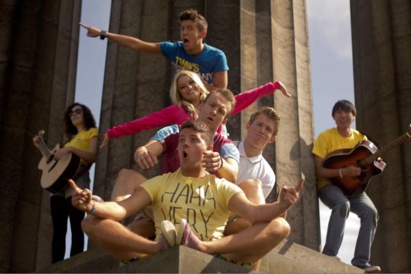 Glenn Adamson (Blue t-shirt), Jamie Barnard (White T-Shirt), Michael Fletcher (Yellow T-Shirt), Joshua Meredith (West Ham T-Shirt), Hayley Hampson (Pink)  Kobi Pham (male guitarist),  Emily Linden (female guitarist)