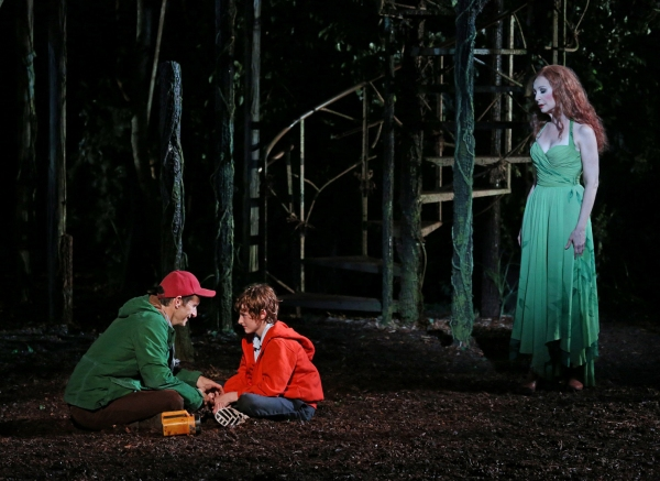 Denis O'Hare, Noah Radcliffe, and Donna Murphy in the Shakespeare in the Park production of Into the Woods, directed by Timothy Sheader with co-direction by Liam Steel, running as part of The Public Theater's 50th Anniversary season at The Delacorte, July