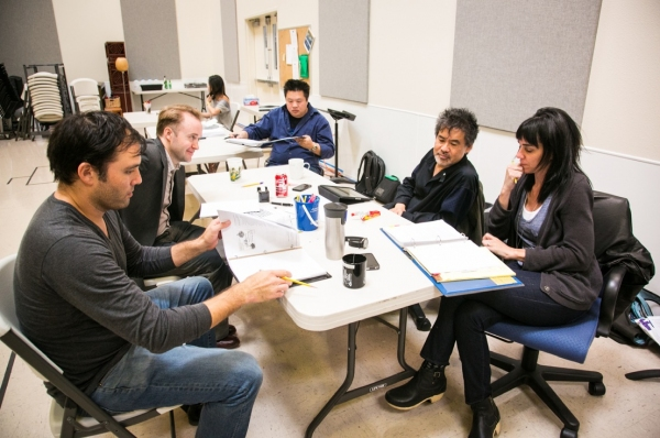 Actors Brian Nishii and Alex Moggridge rehearse with David Henry Hwang and Leigh Silverman