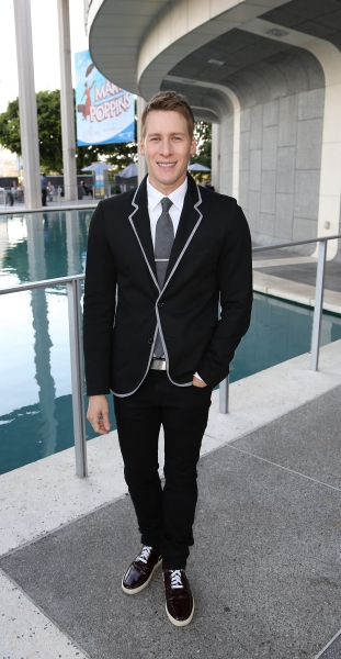 Writer Dustin Lance Black poses during the arrivals for the opening night performance Photo
