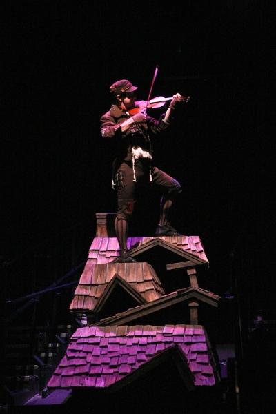 Michael McGurk as The Fiddler