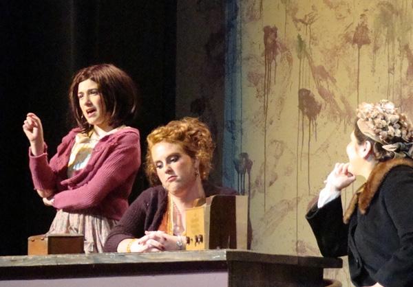 Brigid Harrington as Annie, Caitlin Hughes as Miss Hannigan, and Rachel Guida as Grace Farrell