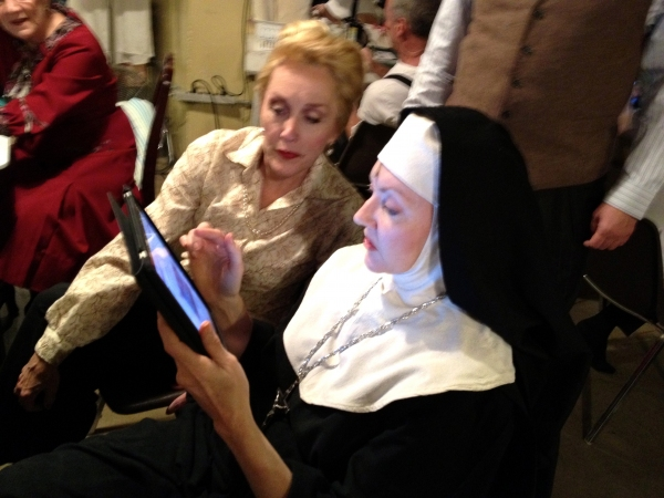 The iPad looks a LITTLE out of place in the hands of Mother Abbess (the GLORIOUS Suzanne Ishee).  But Suzanne doesn't care!  She and Kari Ely are having a youtube break.
