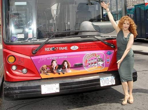 Bernadette Peters shows off her Gray Line New York Ride of Fame™ double-decker bus featuring a custom decal with her likeness alongside her Broadway Barks co-founder, Mary Tyler Moore