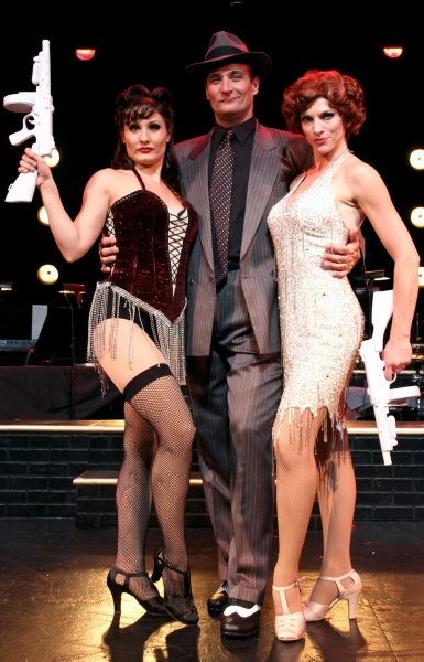 Billy Flynn (Curt Dale Clark), center, shows off his clients Velma Kelly (Marisa Rivera), left, and Roxie Hart (Deb Wims)
