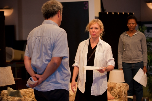 Ensemble member Mariann Mayberry (center) rehearses a scene with Keith Kupferer (left) and ensemble member Alana Arenas (right)