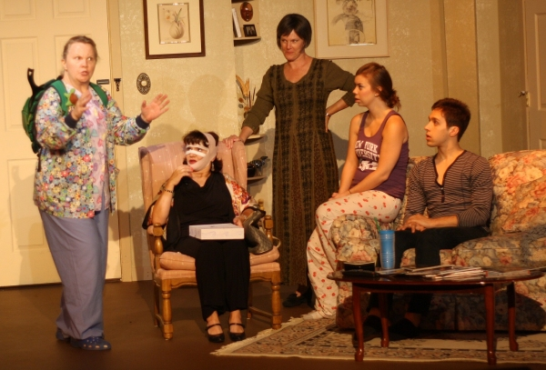 Nurse Barbara Bicknell (LuAnne) describes her own book to famous writer, Nancy Cooper (Kitty) as Barbie Weisserman (Mia), Erin Hildebrandt (Sarah), and Michael Lopetrone (Alex) watch.