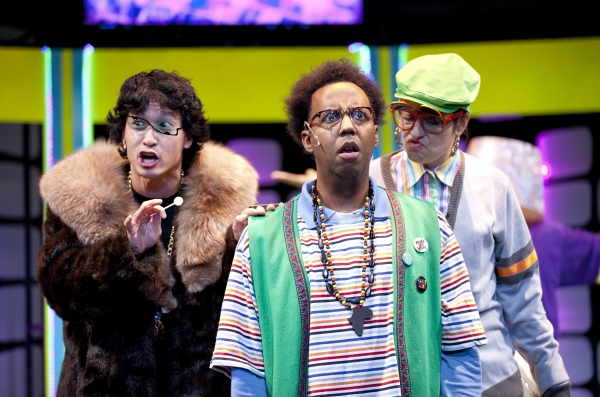 G.Petto (James Johnson, center) is in trouble with his boss, the Machine Master (Jacob Yeh, left), and Crony (Katy Carkuff, right) at Imagination Stage Hits 'Repeat' for P.NOKIO: A HIP-HOP MUSICAL