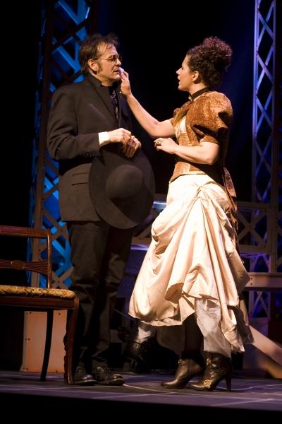 Chip Simmons as Sherlock Holmes and Katharine Hatcher as Irene Adler