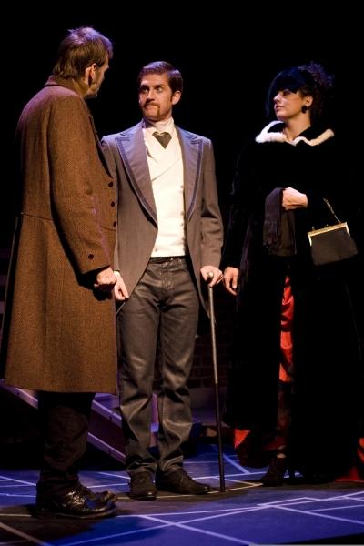Chip Simmons as Sherlock Holmes, Blake Weir as Doctor Watson, and Katharine Hatcher as Irene Adler