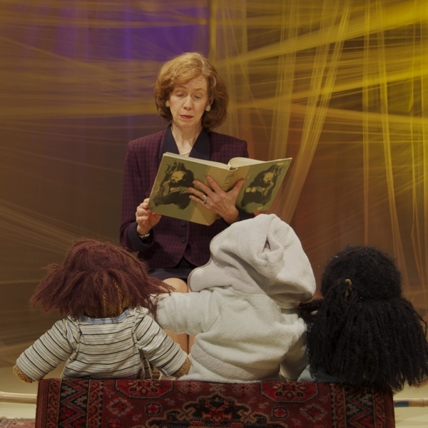 Mary Ewald as Laura Bush reads to dead Iraqi children in Paradise