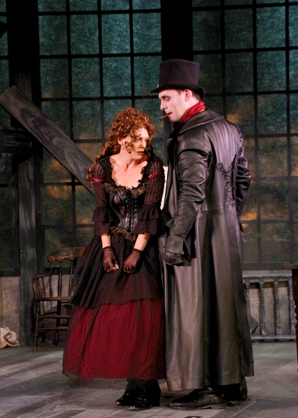 Jeffrey M. Bender as the brutal thief Bill Sikes and Corey Tazmania as Nancy, a thief Photo