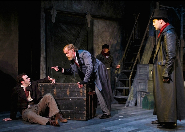 Robbie Collier Sublett as the Artful Dodger; Ames Adamson as Fagin, a receiver of stolen goods; Jeffrey M. Bender as Bill Sikes, a brutal thief with Quentin McCuiston (rear) as Oliver Twist