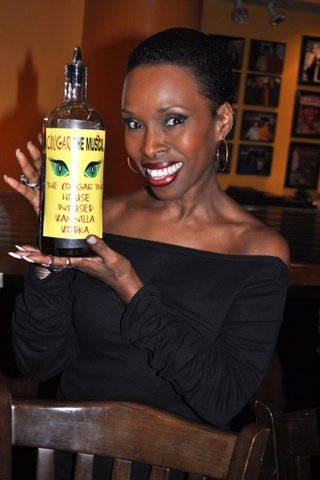 Brenda Braxton poses with the Cougartini's Special ingrediant (Vanilla Vodka and Pom Juice) at COUGAR THE MUSICAL's 'Cougartini' Added to B. Smith's Broadway Drink Menu