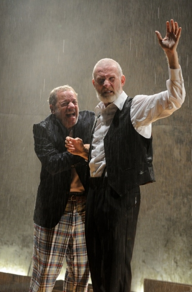 : Stephen Berenson as The Fool and Brian McEleney's King Lear are caught in the rain during the storm scene