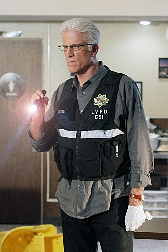 """Code Blue Plate Special"" -- D.B. Russell (Ted Danson) shines a light at the crime scene as he imagines what happened"
