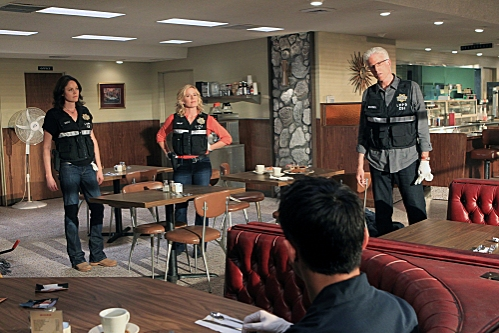 Sara Sidle (Jorja Fox, left), Julie Finlay (Elisabeth Shue, middle) and D.B. Russell (Ted Danson) all focus in on one area of the diner