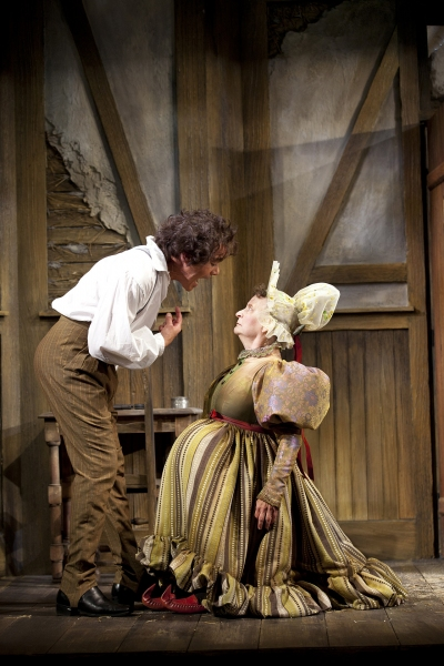 Derek Smith as Hlestakov and Sarah Marshall as the Innkeeper's Wife