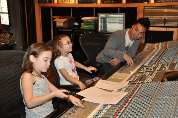 Eliza Holland Madore and Ripley Sobo get advice from Andros Rodriguez (Engineer) on how to run a recording session at Photo Exclusive: ONCE Cast Records for 'Carols For A Cure'