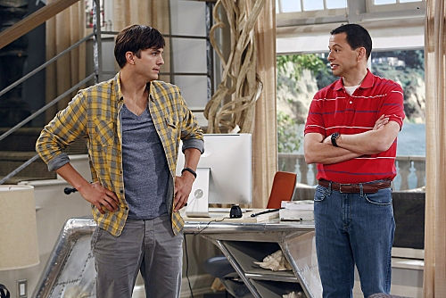 'You Know What the Lollipop is For'--Walden (Ashton Kutcher, left) starts to feel his age when Missi, the daughter of a friend, comes to town, on TWO AND A HALF MEN, Thursday, Oct. 18 (8:30-9:00 PM, ET/PT) on the CBS Television Network. Also pictured: Jo at First Look at Miley Cyrus on TWO AND A HALF MEN