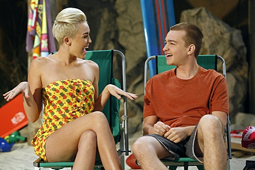 'You Know What the Lollipop is For'--Jake (Angus T. Jones, left) spends time with Missi (special guest star Miley Cyrus, right) at the beach, on TWO AND A HALF MEN, Thursday, Oct. 18 (8:30-9:00 PM, ET/PT) on the CBS Television Network.  Photo: Greg Gayne/ at First Look at Miley Cyrus on TWO AND A HALF MEN