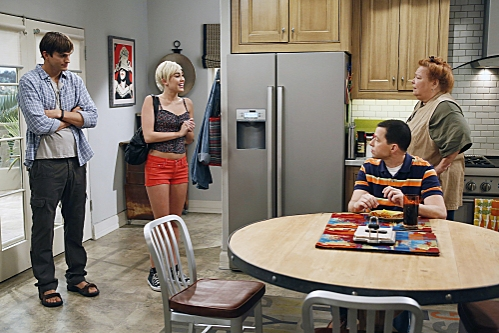 """You Know What the Lollipop is For""--Walden (Ashton Kutcher, left) introduces Missi (special guest star Miley Cyrus, center) to Alan (Jon Cryer, front right) and Berta (Conchata Ferrell, back right), on TWO AND A HALF MEN, Thursday, Oct. 18 (8:30-9:00 PM"