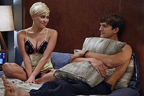 'You Know What the Lollipop is For'--Walden (Ashton Kutcher, right) starts to feel his age when Missi (special guest star Miley Cyrus, left), the daughter of a friend, comes to town, on TWO AND A HALF MEN, Thursday, Oct. 18 (8:30-9:00 PM, ET/PT) on the C at First Look at Miley Cyrus on TWO AND A HALF MEN
