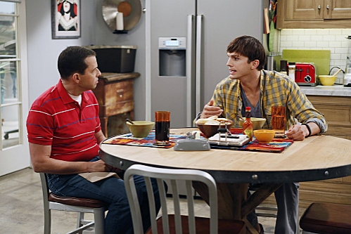 'You Know What the Lollipop is For'--Walden (Ashton Kutcher, right) confesses to Alan (Jon Cryer, left) that he is starting to feel old, on TWO AND A HALF MEN, Thursday, Oct. 18 (8:30-9:00 PM, ET/PT) on the CBS Television Network. Photo: Greg Gayne/Warne at First Look at Miley Cyrus on TWO AND A HALF MEN