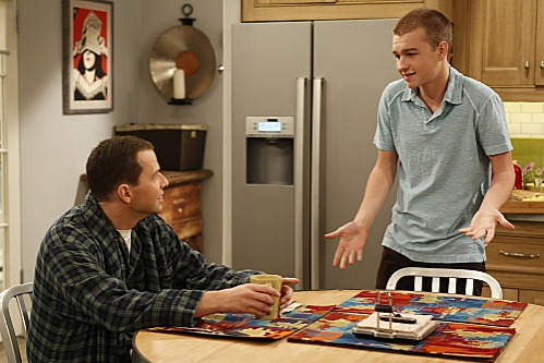 'You Know What the Lollipop is For'--Jake (Angus T. Jones, right) takes a break from the army to visit his dad, Alan (Jon Cryer, left), on TWO AND A HALF MEN, Thursday, Oct. 18 (8:30-9:00 PM, ET/PT) on the CBS Television Network. Photo: Greg Gayne/Warner at First Look at Miley Cyrus on TWO AND A HALF MEN